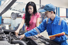 Car mechanic checks the machine with the owner Stock Photo