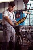 Car mechanic diagnosing broken engine Stock Photos