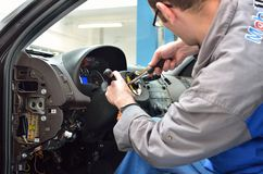 Automotive worker disassemble the steering car Stock Photography