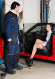 Car mechanic with female customer Royalty Free Stock Photography