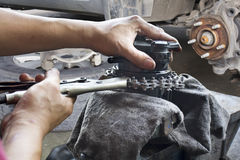 Car mechanic fixing parts of automobile Stock Photo