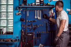 Car mechanic and his tools Stock Images