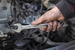 Car mechanic hold spanner tool in hand Stock Image