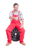 Car mechanic holding keys or wrenches Royalty Free Stock Image