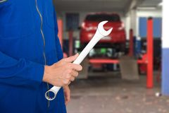 Car Mechanic Holding Spanner royalty free stock photos