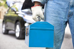 Free Car Mechanic Holding Toolbox Royalty Free Stock Image - 27638016