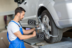Car mechanic installing sensor Stock Images
