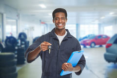 Car mechanic with key. Royalty Free Stock Photography