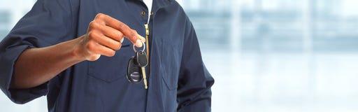 Car mechanic with key. Stock Photo