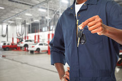 Car mechanic with key. Stock Images