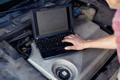 Car mechanic with laptop stock photo