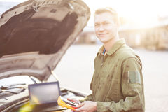 Car mechanic measuring engine Stock Photo
