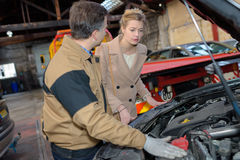 Car mechanic point out towards customer car problem stock images