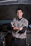 Car Mechanic Portrait. A portrait of a mechanic working in an auto repair shop stock photos