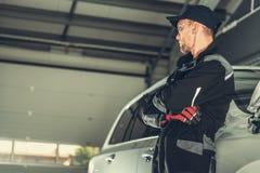 Car Mechanic Profession. Caucasian Men in His 30s Inside His Vehicle Repair Shop stock photos