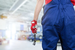 Car mechanic ready to work at service station. Copy space royalty free stock photos