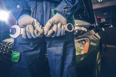 Car Mechanic Ready For Work. Auto Mechanic with Large Wrench in Hands royalty free stock image