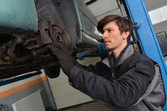 Car mechanic repair brakes Stock Images