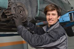 Car mechanic repair brakes Royalty Free Stock Photo
