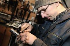 Car mechanic at repair work Stock Photos