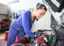 Car mechanic repairing a automobile Stock Photo