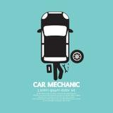 Car Mechanic Repairing Under Automobile Stock Photo