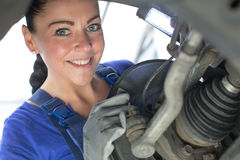 Car mechanic repairs the brakes Royalty Free Stock Images