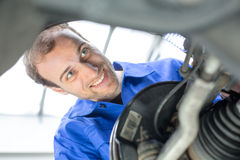 Car mechanic repairs the brakes Stock Photos