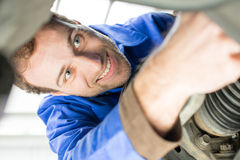 Car mechanic repairs the brakes Royalty Free Stock Image