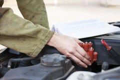 Car mechanic replacing part Stock Photo