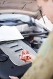 Car mechanic replacing part Royalty Free Stock Photos