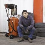Car mechanic resting. Machine shop Stock Photos