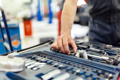 Car mechanic selecting the right tool. For the job royalty free stock image