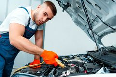 Car mechanic at the service station Royalty Free Stock Image