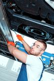 Car mechanic at the service station Royalty Free Stock Photos