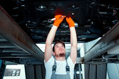 Car mechanic at the service station Royalty Free Stock Images
