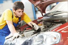 Car mechanic with sparking plug Stock Photography