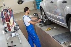 Car mechanic stop terminate on sensor Stock Photos