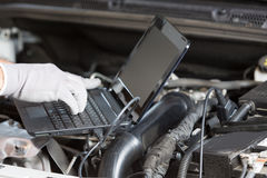 Car mechanic with a tablet Stock Photo