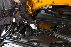 Car mechanic with a tablet Royalty Free Stock Photo