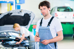 Car Mechanic team working in auto workshop Stock Photo