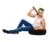 Car mechanic with tire Royalty Free Stock Image