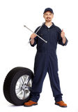 Car mechanic with a tire wrench. Stock Image