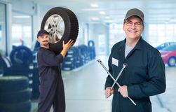 Car mechanic  with tire wrench. Stock Photography