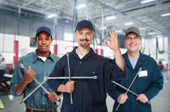 Car mechanic  with tire wrench. Royalty Free Stock Photography