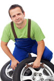 Car mechanic with tires Stock Image