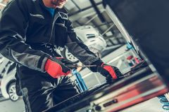 Car Mechanic Tool Box. Caucasian Auto Service Worker Looking For Right Tool royalty free stock image