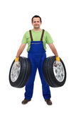 Car mechanic with two tires Stock Photos
