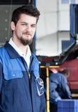 Car mechanic at work Royalty Free Stock Image