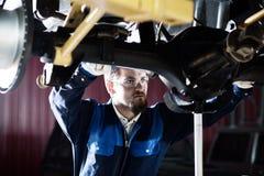 Car mechanic at work Stock Photos